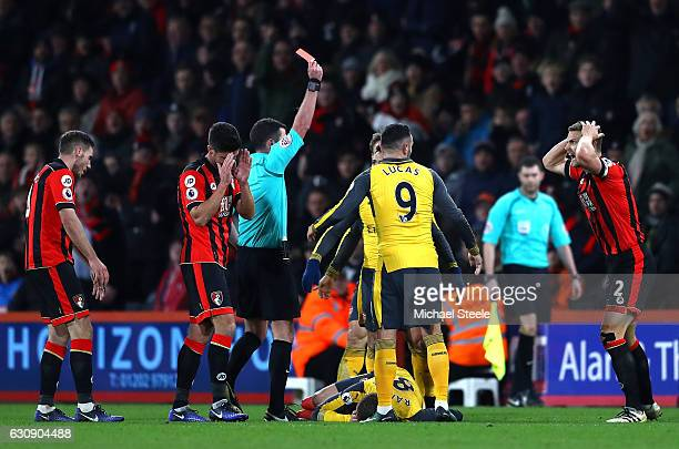 Simon Francis of AFC Bournemouth reacts after receiving a red card by referee Michael Oliver during the Premier League match between AFC Bournemouth...