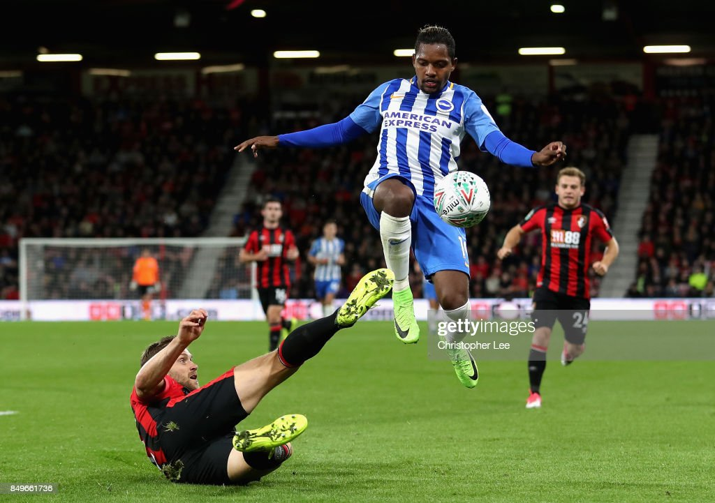 Simon Francis of AFC Bournemouth tackles Elvis Manu of Brighton and Hove Albion during the Carabao Cup Third Round match between AFC Bournemouth and Brighton and Hove Albion at Vitality Stadium on September 19, 2017 in Bournemouth, England.