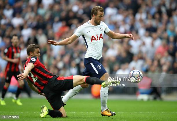 Simon Francis of AFC Bournemouth tackles Harry Kane of Tottenham Hotspur during the Premier League match between Tottenham Hotspur and AFC...