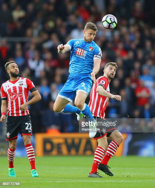 Simon Francis of AFC Bournemouth wins a header over Jay Rodriguez of Southampton during the Premier League match between Southampton and AFC...