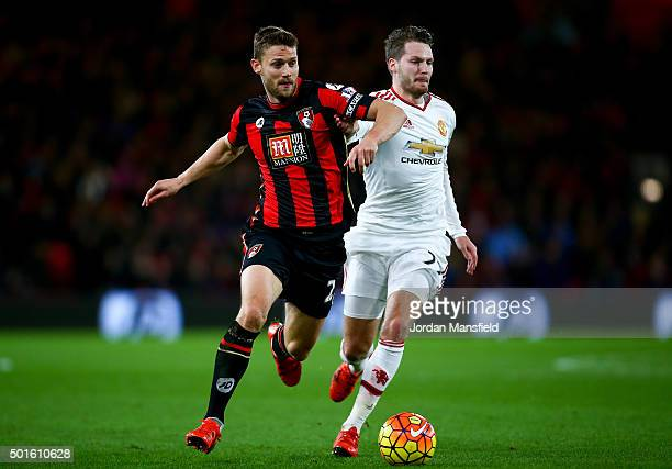 Simon Francis of Bournemouth and Nick Powell of Manchester United compete for the ball during the Barclays Premier League match between AFC...