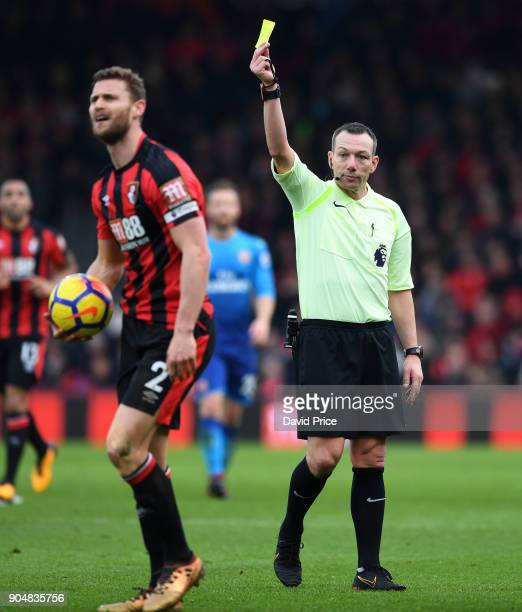 Simon Francis of Bournemouth is booked by Referee Kevin Friend during the Premier League match between AFC Bournemouth and Arsenal at Vitality...