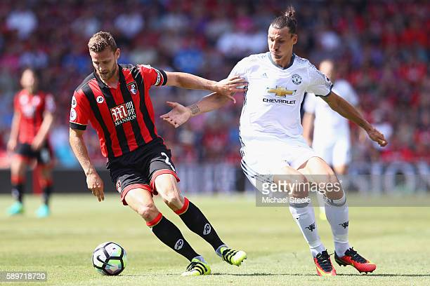 Simon Francis of Bournemouth is tracked by Zlatan Ibrahimovic of Manchester United during the Premier League match between AFC Bournemouth and...