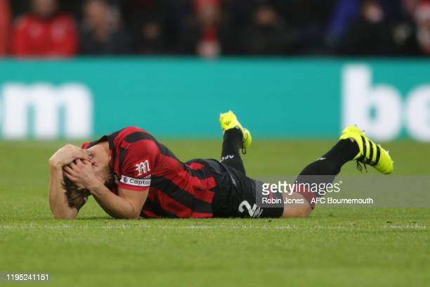 Simon Francis of Bournemouth needs treatment after a high foot from Ashley Barnes of Burnley during the Premier League match between AFC Bournemouth...