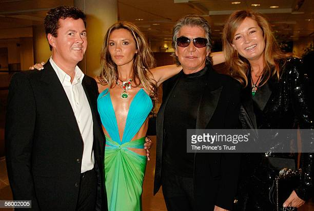 Simon Fuller Victoria Beckham Roberto Cavalli and his wife Eva attends the champagne reception at the Swarovski Fashion Rocks for The Prince's Trust...