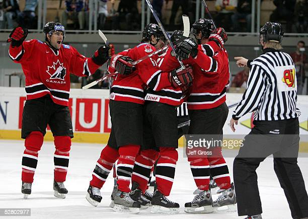 Simon Gagne of Canada celebrates his goal with teammates Chris Phillips and Rick Nash in the third period against Slovakia in the IIHF World Men's...