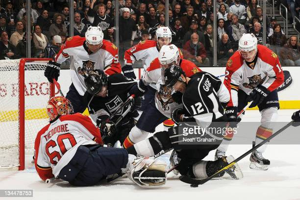 Simon Gagne of the Los Angeles Kings tries to score against Jose Theodore of the Florida Panthers at Staples Center on December 1 2011 in Los Angeles...