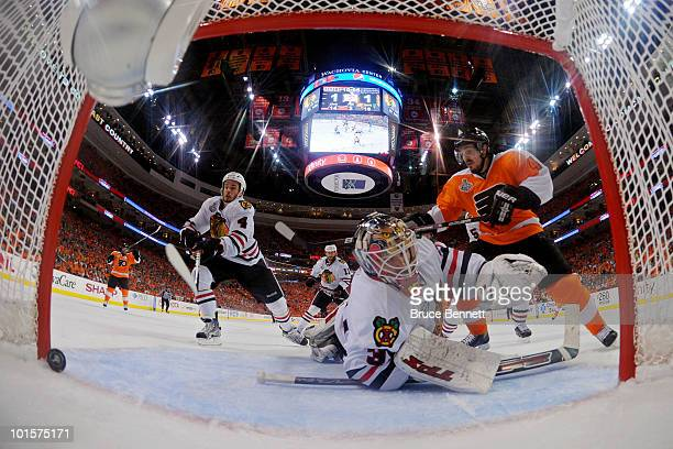 Simon Gagne of the Philadelphia Flyers celebrates the goal made by Scott Hartnell against Antti Niemi Niklas Hjalmarsson of the Chicago Blackhawks in...