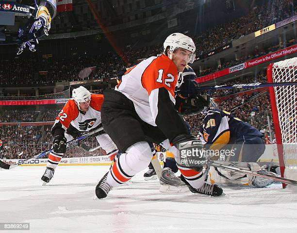 Simon Gagne of the Philadelphia Flyers reaches for the puck against the Buffalo Sabres on November 21, 2008 at HSBC Arena in Buffalo, New York.
