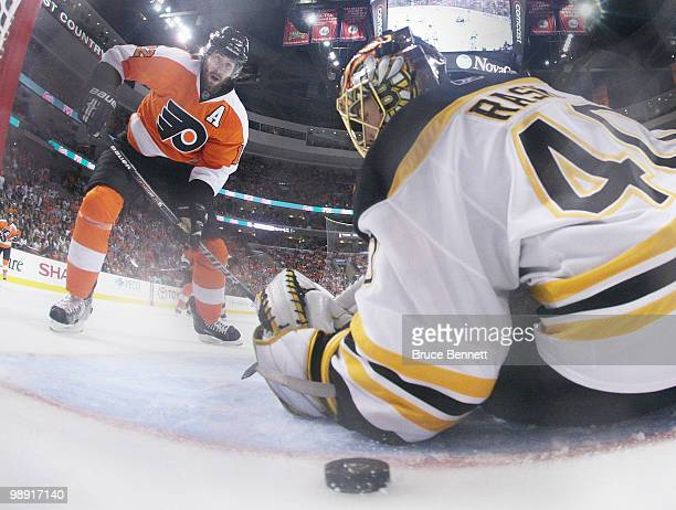 Simon Gagne of the Philadelphia Flyers scores at 14:40 of overtime against Tuukka Rask of the Boston Bruins in Game Four of the Eastern Conference...