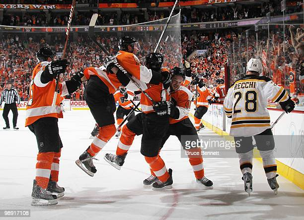 Simon Gagne of the Philadelphia Flyers scores at 14:40 of overtime to defeat the Boston Bruins in Game Four of the Eastern Conference Semifinals...