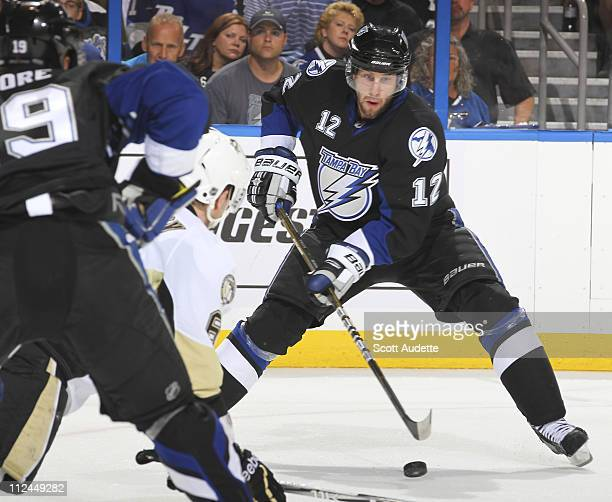 Simon Gagne of the Tampa Bay Lightning passes the puck Ben Lovejoy of the Pittsburgh Penguins in Game Three of the Eastern Conference Quarterfinals...