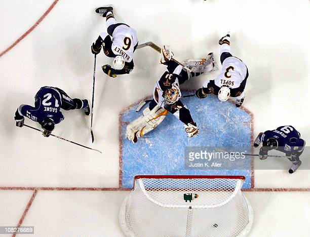 Simon Gagne of the Tampa Bay Lightning shoots and scores a power play goal past Peter Mannino of the Atlanta Thrashers at St Pete Times Forum on...