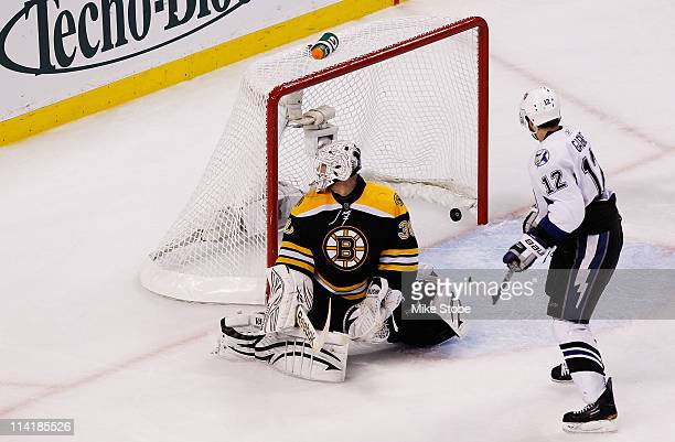 Simon Gagne of the Tampa Bay Lightning watches his third period goal pass Tim Thomas of the Boston Bruins in Game One of the Eastern Conference...