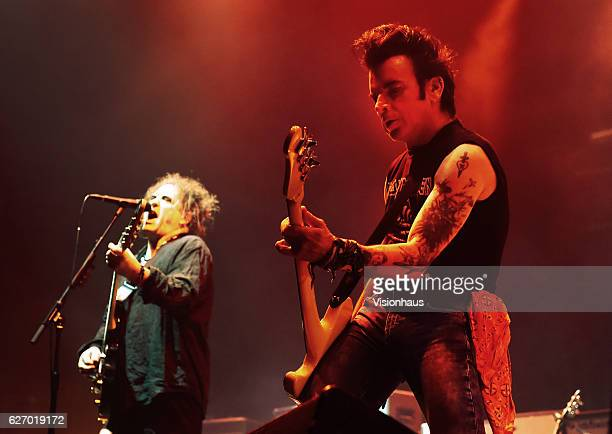 Simon Gallup and Robert Smith of The Cure perform at the Manchester Arena on November 29 2016 in Manchester England