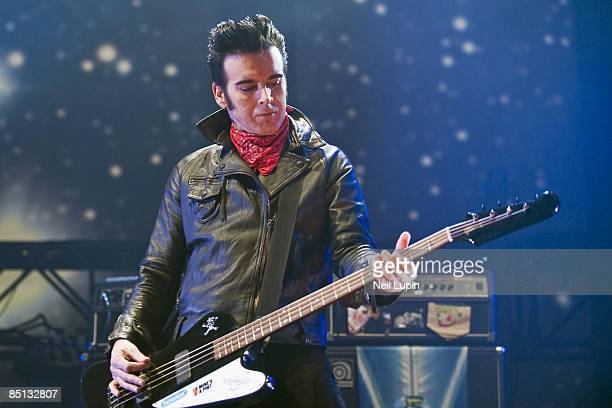 Simon Gallup of The Cure performs at the O2 Arena on February 26 2009 in London England