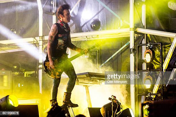 Simon Gallup of The Cure performs onstage headlining day 3 of Bestival 2016 at Robin Hill Country Park on September 10 2016 in Newport Isle of Wight