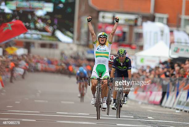 Simon Gerrans of Australia and Orica GreenEDGE celebrates after he crosses the finish line to win the 100th edition of the LiegeBastogneLiege road...
