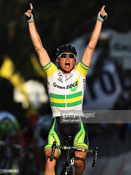 Simon Gerrans of Australia and the Greenedge Cycling team celebrates as he crosses the line to win the 2012 Milan Sanremo cycle race on March 17 2012...
