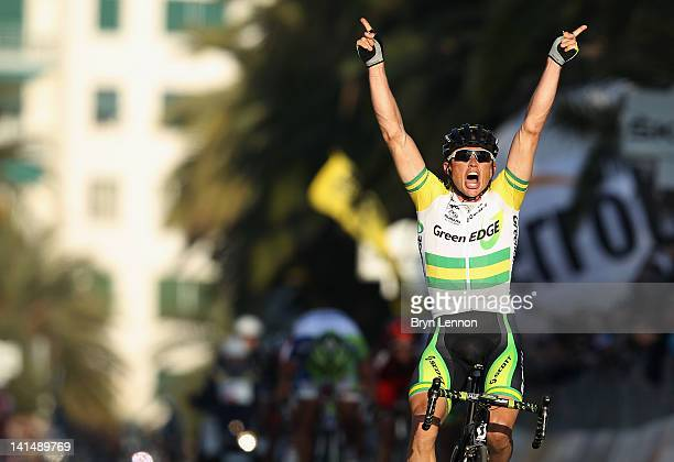 Simon Gerrans of Australia and the Greenedge Cycling team celebrates as he crosses the line to win the 2012 Milan Sanremo cycle race on March 17,...