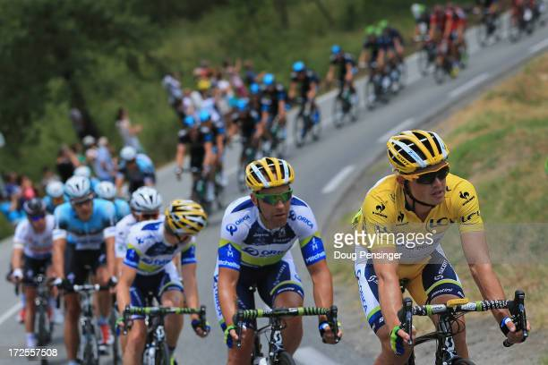 Simon Gerrans of Australia riding for OricaGreenEdge rides in the peloton as he successfully defends the overall race leader's yellow jersey during...