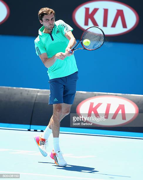 Simon Gilles of France plays a backhand in his first round match against Vasek pospisil of Canada during day one of the 2016 Australian Open at...