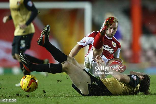 Simon Gillett of Bristol City is upended by a challenge from Romain Vincelot of Leyton Orient during the Sky Bet League One match between Bristol...