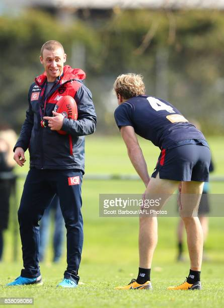 Simon Goodwin coach of the Demons smiles as he looks towards Jack Watts of the Demons during a Melbourne Demons AFL training session at Gosch's...