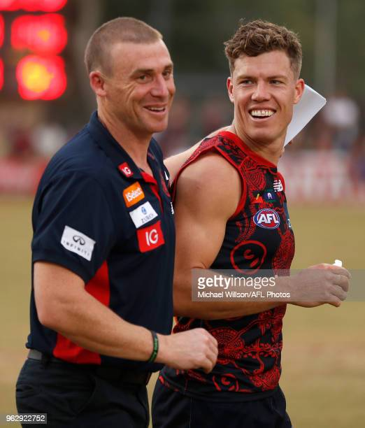 Simon Goodwin Senior Coach of the Demons and Jake Melksham of the Demons celebrate during the 2018 AFL round 10 match between the Melbourne Demons...