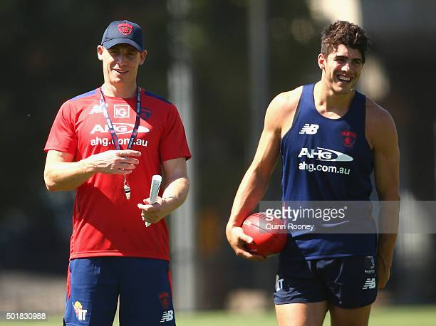 Simon Goodwin the assistant coach of the Demons talks to Christian Petracca during a Melbourne Demons AFL preseason training session at Gosch's...