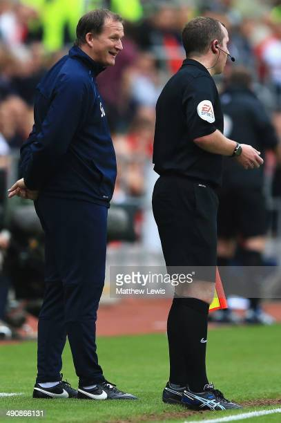 Simon Grayson manager of Preston North End talks to the fourth official during the Sky Bet League One Play Off Semi Final Second Leg between at...
