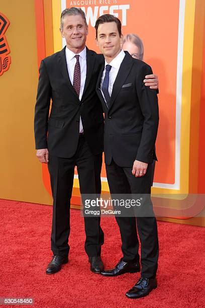 Simon Halls and Matt Bomer arrive at the premiere of Warner Bros Pictures' The Nice Guys at TCL Chinese Theatre on May 10 2016 in Hollywood California