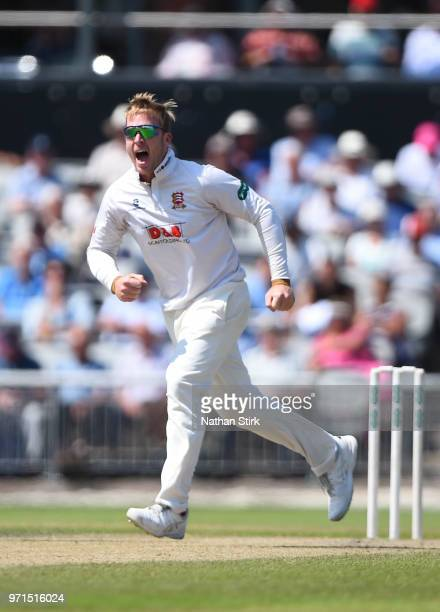 Simon Harmer of Essex celebrates after getting Dane Vilas of Lancashire out during the Specsavers Championship Division One match between Lancashire...