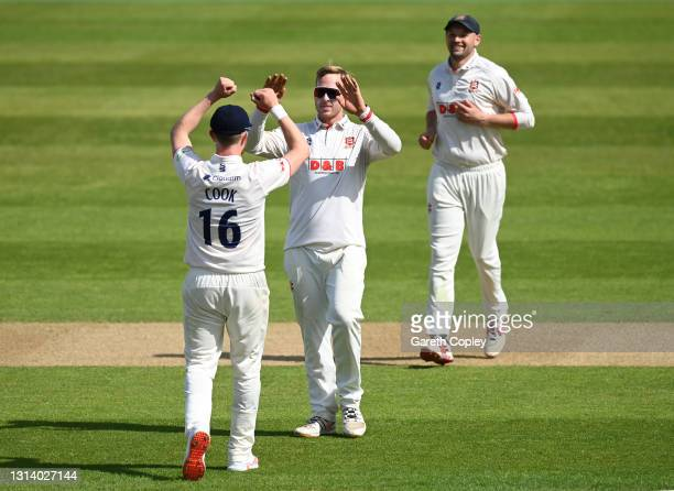Simon Harmer of Essex celebrates dismissing Sam Hain of Warwickshire during the LV= Insurance County Championship match between Warwickshire and...