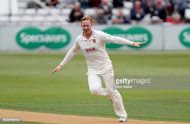 Simon Harmer of Essex celebrates taking the wicket of Dawid malan during the Specsavers County Championship Division One match between Essex and...