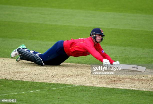 Simon Harmer of Essex dives to make his ground during the Royal London OneDay Cup match between Surrey and Essex at The Kia Oval on May 2 2017 in...