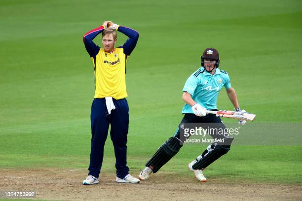 Simon Harmer of Essex Eagles reacts as Ben Geddes of Surrey runs between the wickets during the Vitality T20 Blast match between Surrey and Essex...