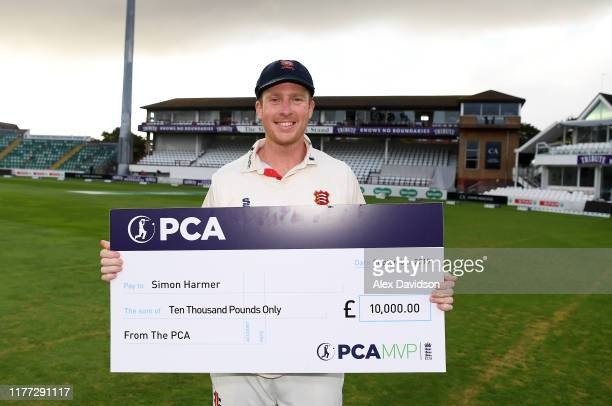 Simon Harmer of Essex is presented with a cheque for winning the Overall PCA Most Valuable Player Rankings during Day Four of the Specsavers County...