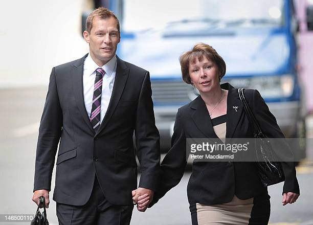 Simon Harwood arrives at Southwark Crown Court with his wife Helen on June 18 2012 in London England PC Harwood is charged with manslaughter after...