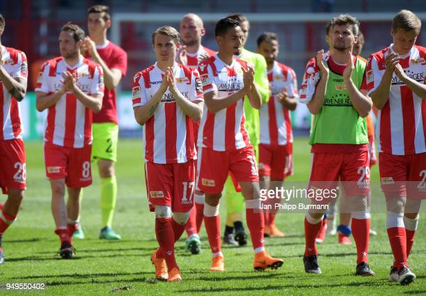 Simon Hedlund and Michael Parensen of 1 FC Union Berlin acknowledge the fans after the match between Union Berlin and 1. FC Heidenheim at the Stadion...