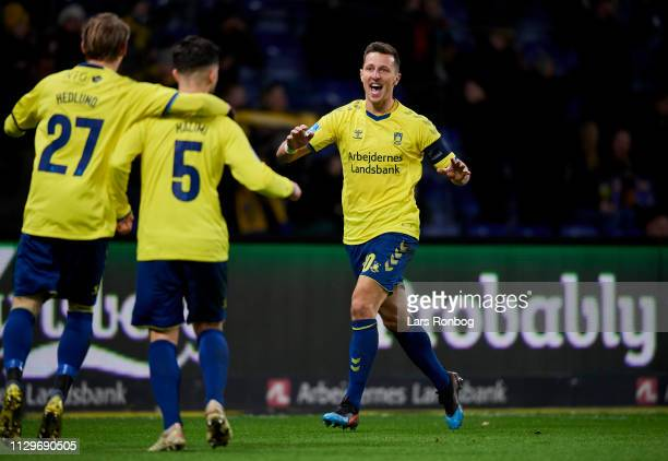 Simon Hedlund Besar Halimi and Kamil Wilczek of Brondby IF celebrate after scoring their second goal during the Danish Superliga match between...