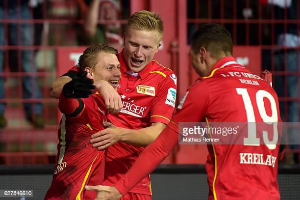 Simon Hedlund Kristian Pedersen and Damir Kreilach of 1 FC Union Berlin celebrate after scoring the 10 during the game between dem 1 FC Union Berlin...