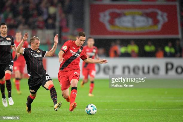 Simon Hedlund of 1 FC Union Berlin and Dominik Kohr of Bayer 04 Leverkusen during the game between Bayer 04 Leverkusen and Union Berlin on october 24...