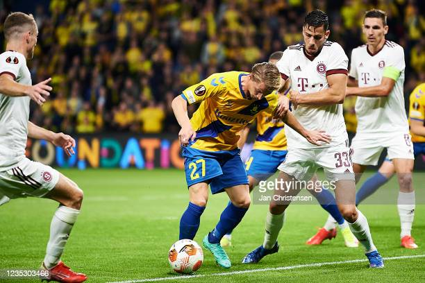 Simon Hedlund of Brondby IF and David Hancko of AC Sparta Praha compete for the ball during the UEFA Europa League match between Brondby IF and AC...