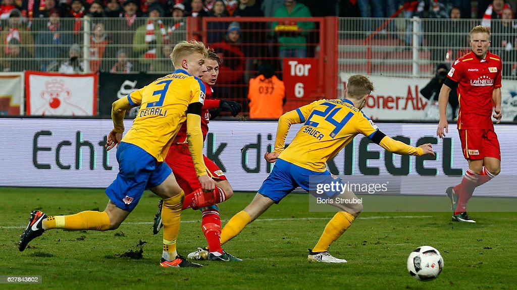 Simon Hedlund (2.L) of Union Berlin scores his team's first goal during the Second Bundesliga match between 1. FC Union Berlin and Eintracht Braunschweig at Stadion An der Alten Foersterei on December 5, 2016 in Berlin, Germany.