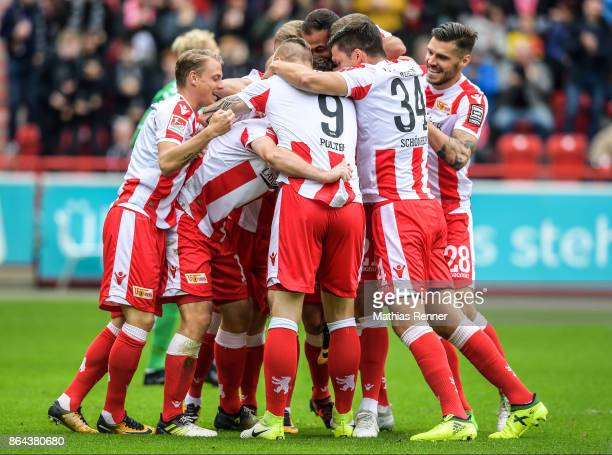 Simon Hedlund Sebastian Polter Steven Skrzybski and Christopher Trimmel of 1 FC Union Berlin celebrate after scoring the 10 during the game between...