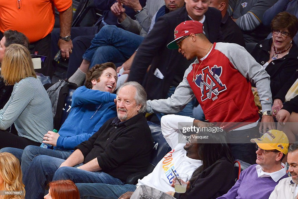 Simon Helberg (L) and T.I. attend a basketball game between the Utah Jazz and the Los Angeles Lakers at Staples Center on January 25, 2013 in Los Angeles, California.