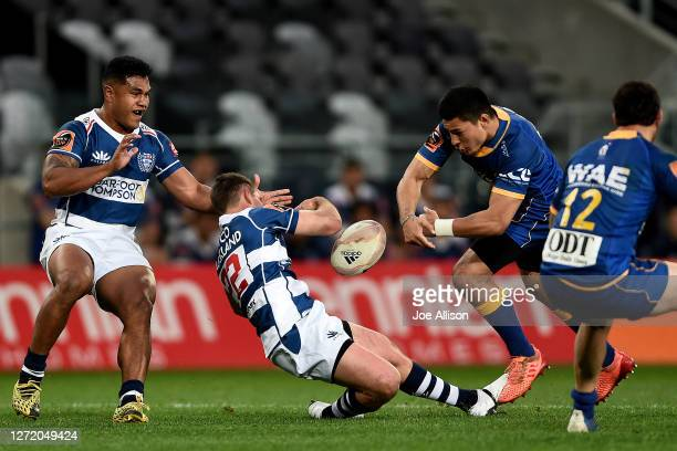 Simon Hickey of Auckland is impacted after an illegal tackle which lead to a red card for Patelesio Tomkinson during the round 1 Mitre 10 Cup match...