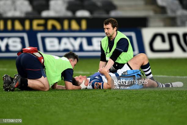Simon Hickey of Auckland receives medical attention after being hit by an illegal tackle during the round 1 Mitre 10 Cup match between Otago and...