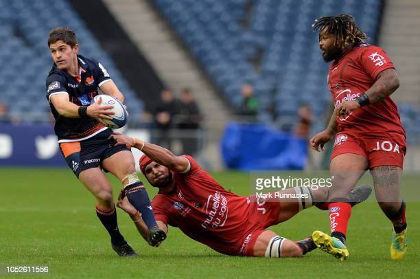 Simon Hickey of Edinburgh Rugby is tackled by Juandre Kruger and Mathieu Bastareaud of Toulon during the Champions Cup match between Edinburgh Rugby...